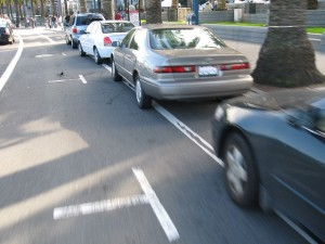 These San Francisco bike lanes are supposed to be next to the curb, with parallel parking lanes acting as a buffer between traffic and cyclists, but drivers continue to park their automobiles right up to the curb, taking over some of the bike lane. Photo courtesy of Flickr, 2013