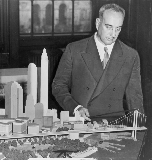 Robert Moses and a model of his unrealized Battery Bridge project. Source - Library of Congress.