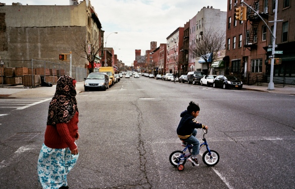 A young family crosses a major street in Bed-Stuy. This historically diverse neighborhood is part of the heart of Brooklyn. Credit Matthew Chamberlain.